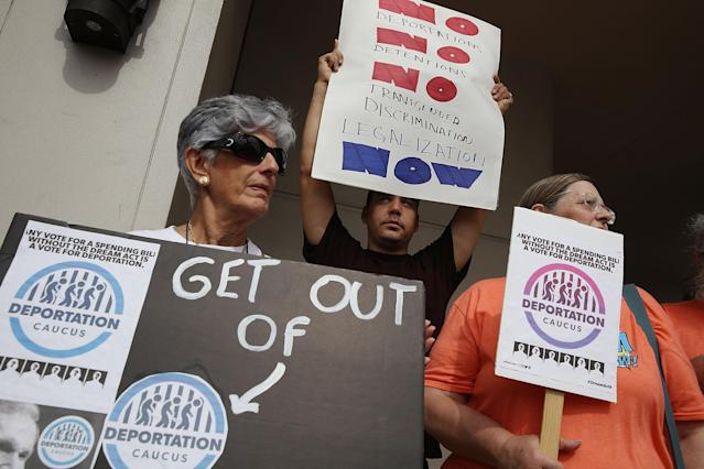 "<p>Activists Silvia Munoz, Santiago Beck and Jeanne Conlin, left to right, outside the office of Sen. Bill Nelson as they ask for his support for Deferred Action for Childhood Arrivals who are people who were brought to this country illegally as children — also known as Dreamers — on Jan. 10, 2018, in Coral Gables, Fla. Sen. Nelson voted in December for a temporary budget that didn't include a solution for Dreamers; the activists want him to vote against any spending bill that does not include a ""clean"" Dream Act. (Photo: Joe Raedle/Getty Images) </p>"
