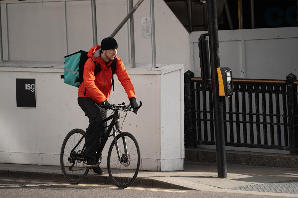 A food delivery rider working for Deliveroo in London, an example of the so-called gig economy. Photo date: Wednesday, March 18, 2020. Photo credit should read: Richard Gray/EMPICS