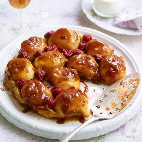 """<p>This simplified version of the French classic makes a stunning finish to any meal.</p><p><strong>Recipe: <a href=""""https://www.goodhousekeeping.com/uk/food/recipes/a535508/apple-and-raspberry-tarte-tatin/"""" rel=""""nofollow noopener"""" target=""""_blank"""" data-ylk=""""slk:Apple and Raspberry Tarte Tatin"""" class=""""link rapid-noclick-resp"""">Apple and Raspberry Tarte Tatin</a></strong></p>"""