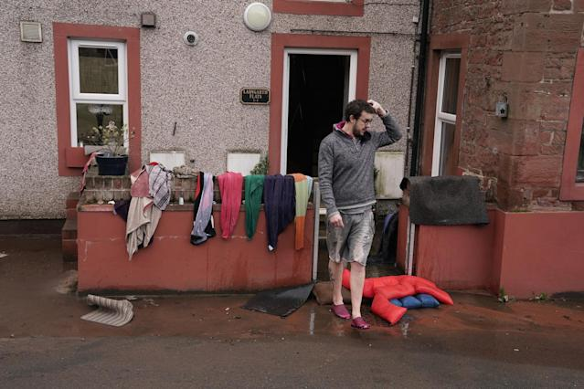 Residents begin to clean up their homes in the flooded streets in Appleby-in-Westmorland, Cumbria. (PA)