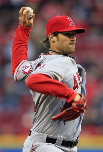 Los Angeles Angels starting pitcher C.J. Wilson throws against the Cincinnati Reds in the first inning of a baseball game, Wednesday, April 3, 2013, in Cincinnati. (AP Photo/Al Behrman)