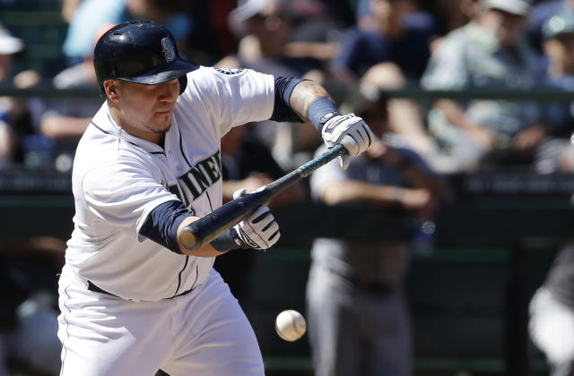 Seattle Mariners catcher Jesus Sucre lays down a sacrifice bunt against the Chicago White Sox in the seventh inning of a baseball game, Sunday, Aug. 10, 2014, in Seattle. (AP Photo/Ted S. Warren)