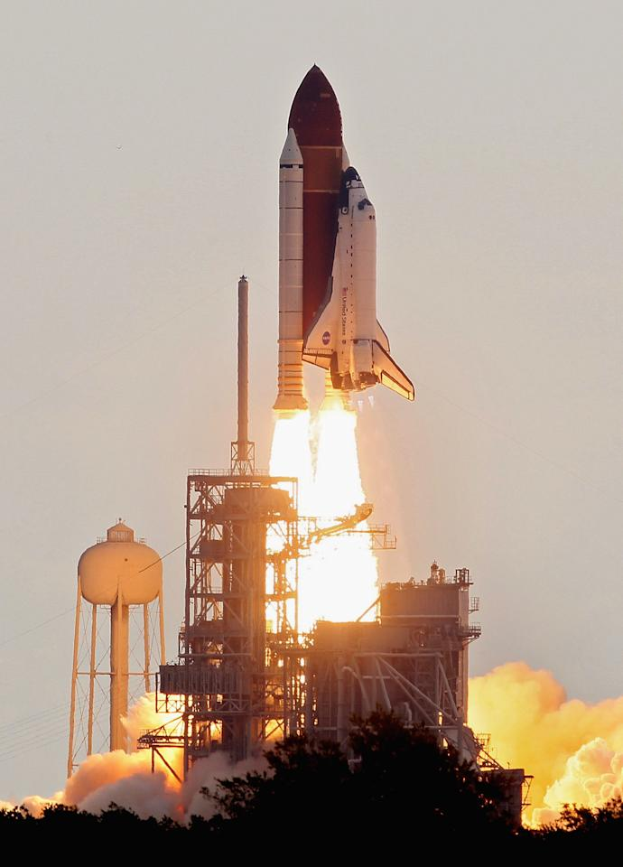 CAPE CANAVERAL, FL - MAY 16:  NASA space shuttle Endeavour lifts off from Launch Pad 39A at the Kennedy Space Center on May 16, 2011 in Cape Canaveral, Florida. After 20 years, 25 missions and more than 115 million miles in space, Endeavour is on its final flight to the International Space Station before being retired and donated to the California Science Center in Los Angeles. Mission STS-134 will deliver the Express Logistics Carrier-3 (ELC-3) and the Alpha Magnetic Spectrometer (AMS-2) to the International Space Station.  (Photo by Mark Wilson/Getty Images)