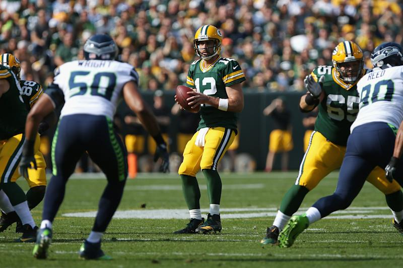 Aaron Rodgers of the Green Bay Packers looks to pass during the first half against the Seattle Seahawks at Lambeau Field in Green Bay Wisconsin