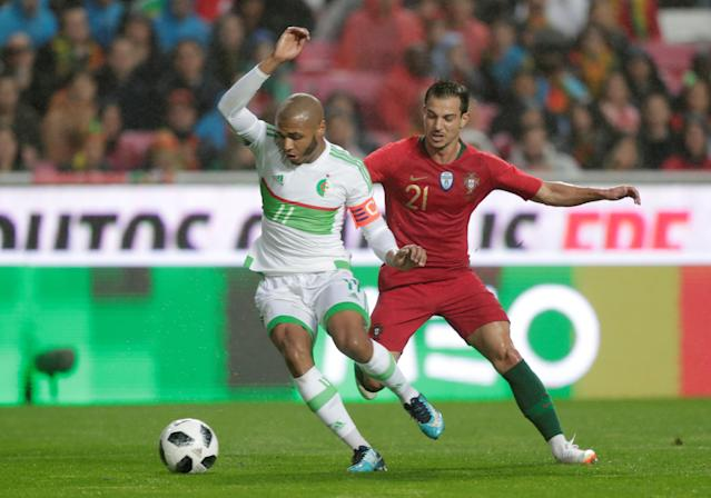 Soccer Football - International Friendly - Portugal vs Algeria - Estadio da Luz, Lisbon, Portugal - June 7, 2018 Algeria's Yacine Brahimi in action with Portugal's Cedric Soares REUTERS/Rafael Marchante