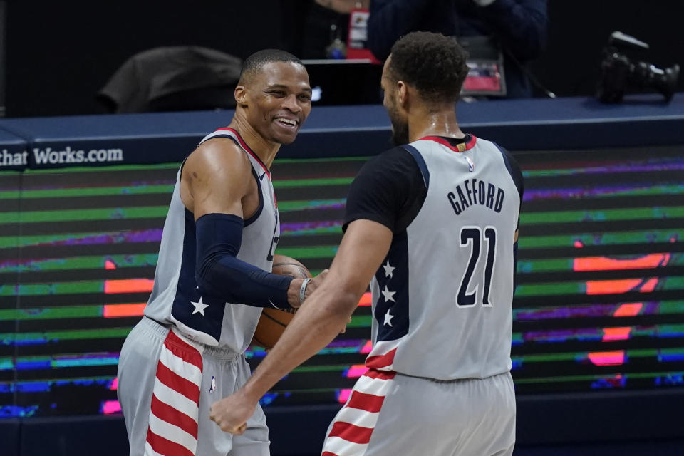 Washington Wizards' Russell Westbrook, left, celebrates with Daniel Gafford following an NBA basketball game against the Indiana Pacers, Saturday, May 8, 2021, in Indianapolis. Washington won 133-132 in overtime. (AP Photo/Darron Cummings)