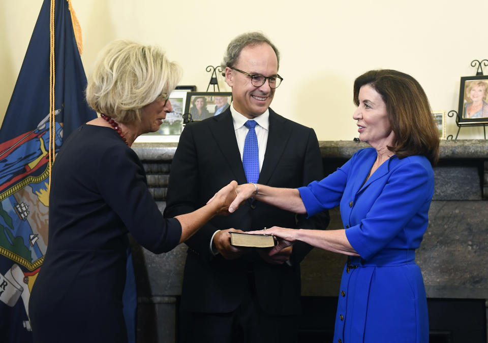 New York Chief Judge Janet DiFiore swears in Kathy Hochul as the first woman to be New York's governor during a swearing-in ceremony in the Red Room at the state Capitol, early Tuesday, Aug. 24, 2021, in Albany, N.Y. (AP Photo/Hans Pennink, Pool)