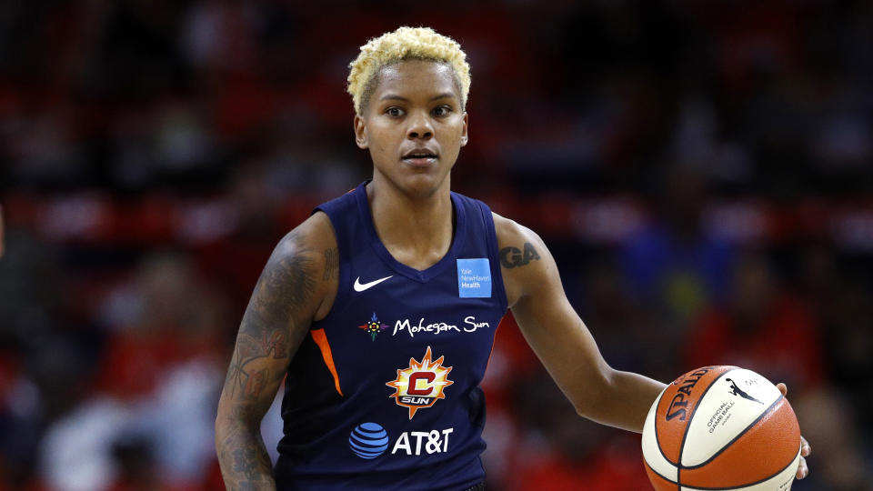 Connecticut Sun guard Courtney Williams drives the ball in the first half of Game 1 of basketball's WNBA Finals against the Washington Mystics, Sunday, Sept. 29, 2019, in Washington. (AP Photo/Patrick Semansky)