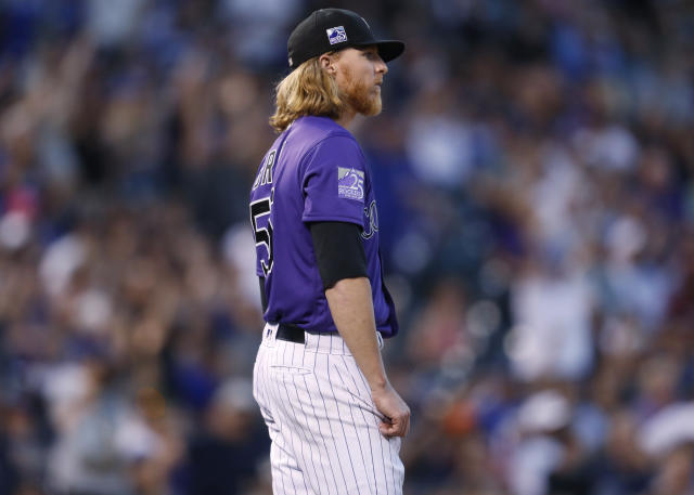 Colorado Rockies starting pitcher Jon Gray reacts after giving up a two-run home run to Los Angeles Dodgers' Max Muncy during the fourth inning of a baseball game Friday, Aug. 10, 2018, in Denver. (AP Photo/David Zalubowski)
