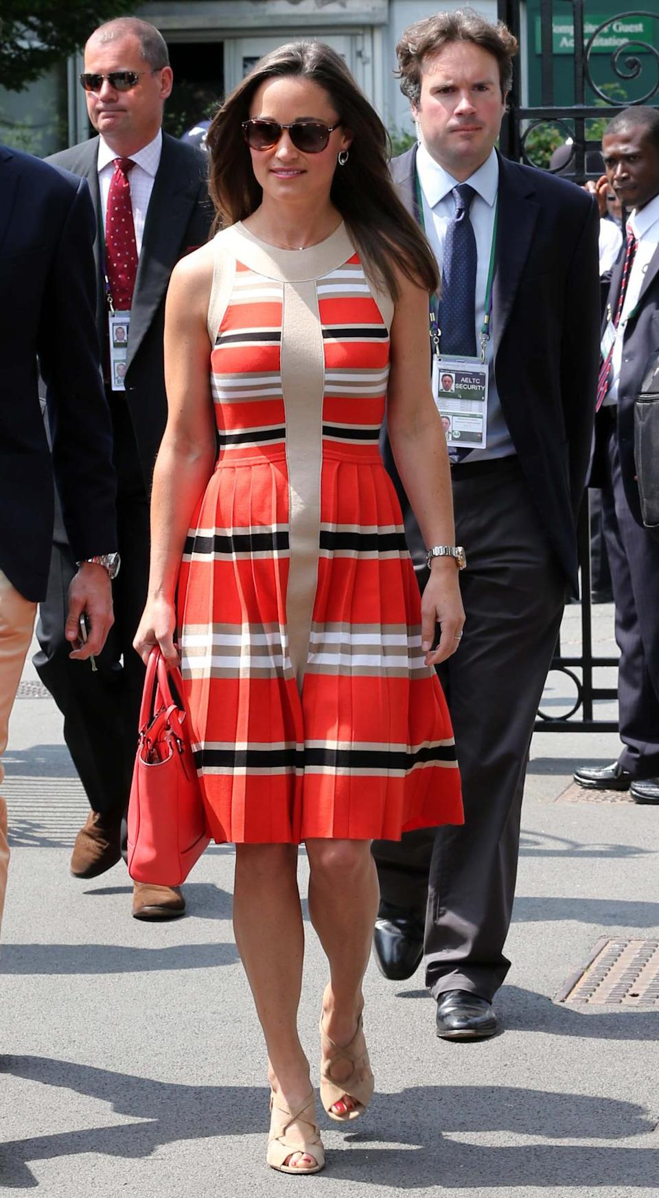 <p>A striped, and pleated skirt, was Pippa's choice for a day out at Wimbledon in 2013. <i>[Photo: Rex]</i> </p>