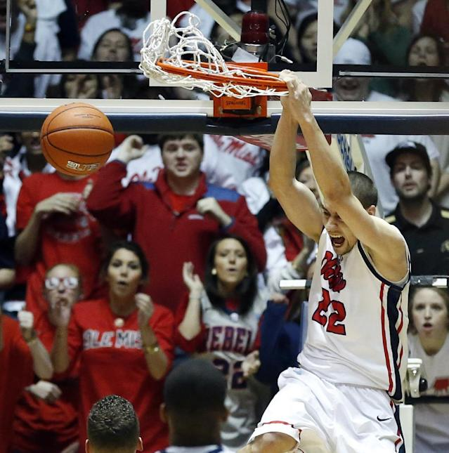 Mississippi guard Marshall Henderson (22) dunks in the first half of an NCAA college basketball game against Florida in Oxford, Miss., Saturday, Feb. 22, 2014. (AP Photo/Rogelio V. Solis)