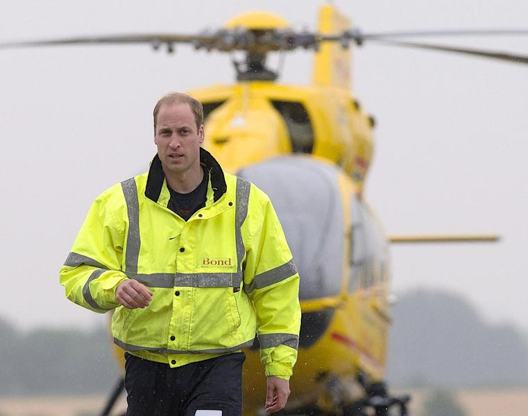 Britain's Prince William begins his new job with the East Anglian Air Ambulance at Cambridge airport on July 13, 2015 (AFP Photo/)