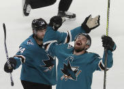San Jose Sharks right wing Joonas Donskoi, right, celebrates with defenseman Marc-Edouard Vlasic (44) after scoring a goal against the Colorado Avalanche during the second period of Game 7 of an NHL hockey second-round playoff series in San Jose, Calif., Wednesday, May 8, 2019. (AP Photo/Jeff Chiu)