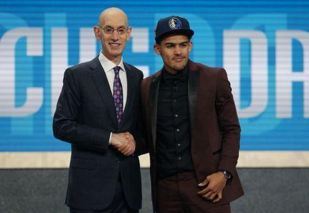 Jun 21, 2018; Brooklyn, NY, USA; Trae Young (Oklahoma) greets NBA commissioner Adam Silver after being selected as the number five overall pick to the Dallas Mavericks in the first round of the 2018 NBA Draft at the Barclays Center. Brad Penner-USA TODAY Sports