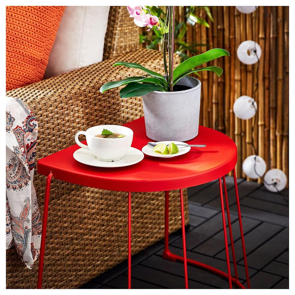 """<p>The <a href=""""https://www.popsugar.com/buy/Tranar%C3%B6-Stool-434470?p_name=Tranar%C3%B6%20Stool&retailer=ikea.com&pid=434470&price=20&evar1=casa%3Aus&evar9=46226851&evar98=https%3A%2F%2Fwww.popsugar.com%2Fhome%2Fphoto-gallery%2F46226851%2Fimage%2F46226963%2FTranar%C3%B6-Stool&list1=shopping%2Cfurniture%2Cikea%2Csummer%2Csmall%20space%20living%2Coutdoor%20decorating%2Chome%20shopping&prop13=api&pdata=1"""" class=""""link rapid-noclick-resp"""" rel=""""nofollow noopener"""" target=""""_blank"""" data-ylk=""""slk:Tranarö Stool"""">Tranarö Stool</a> ($20) works as both a stool or side table! Its flat edge gives it the versatility to fit into compact spaces.</p>"""