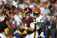 Washington Football Team quarterback Taylor Heinicke (4) looks to pass while under pressure from Cincinnati Bengals defensive end Cameron Sample during the first half of a preseason NFL football game Friday, Aug. 20, 2021, in Landover, Md. (AP Photo/Susan Walsh)