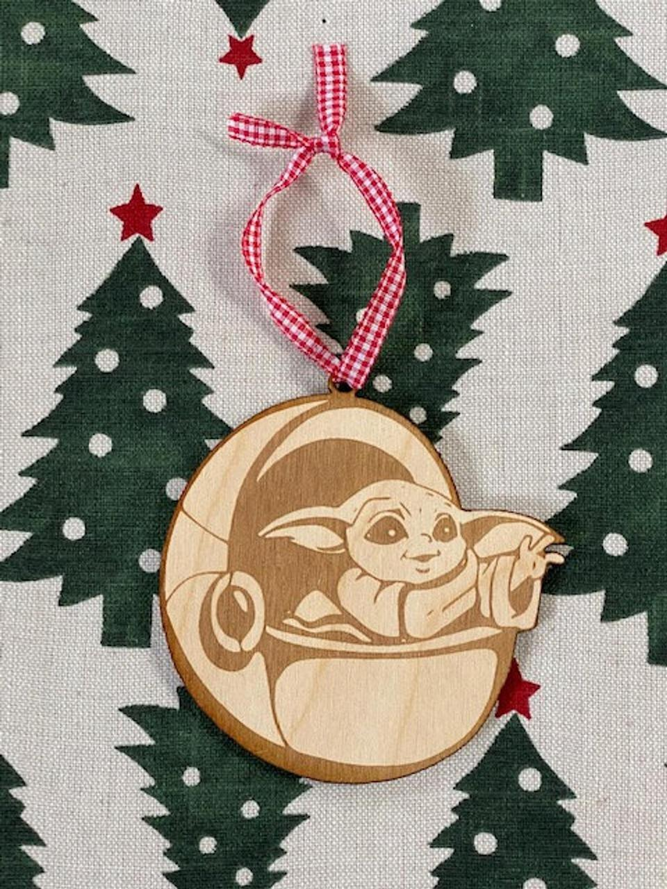 """Get them into the holiday spirit with this ornament that's been handmade in the Midwest. It'll look perfect on a tree or just hanging around on a hook. And they'll definitely want to keep it around for years. <a href=""""https://fave.co/3qpSbVU"""" target=""""_blank"""" rel=""""noopener noreferrer"""">Find it for $8 on Etsy</a>."""