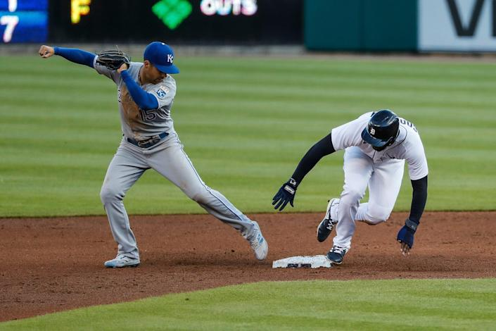 Detroit Tigers short stop Niko Goodrum (28) slides into second base against Kansas City Royals second baseman Whit Merrifield (15) during second inning at Comerica Park in Detroit on Wednesday, May 12, 2021.