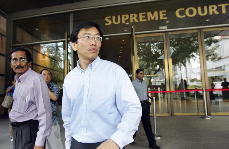 FILE - In this June 2, 2008 file photo, opposition Singapore Democratic Party leader Chee Soon Juan, second from left, leaves the supreme court in Singapore. Chee  has been discharged from bankruptcy, the government said Wednesday, Nov. 21, 2012, after an unprecedented concession by two former prime ministers to whom he owed about $408,000. Ex-prime ministers Lee Kuan Yew and Goh Chok Tong agreed to accept a reduced amount of 30,000 Singapore dollars ($24,500) from Chee, which will free him from bankruptcy proceedings formally on Friday, said a statement by the Insolvency and Public Trustee's Office. (AP Photo/Wong Maye-E, File)