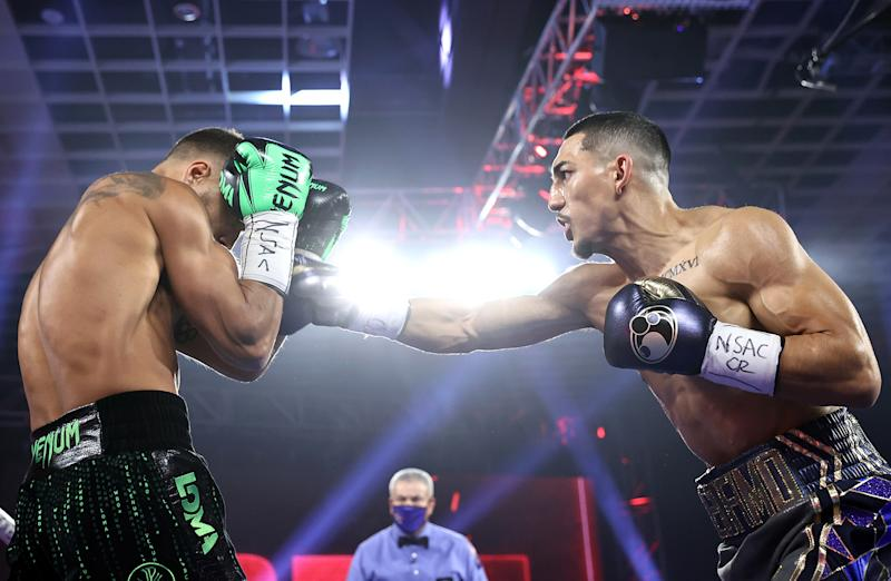 LAS VEGAS, NEVADA - OCTOBER 17: In this handout image provided by Top Rank, Teofimo Lopez Jr punches Vasiliy Lomachenko in their Lightweight World Title bout at MGM Grand Las Vegas Conference Center on October 17, 2020 in Las Vegas, Nevada. (Photo by Mikey Williams/Top Rank via Getty Images)