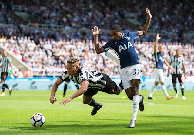 Newcastle United's Dwight Gayle (L) in action with Tottenham Hotspur's Kyle Walker-Peters (R)