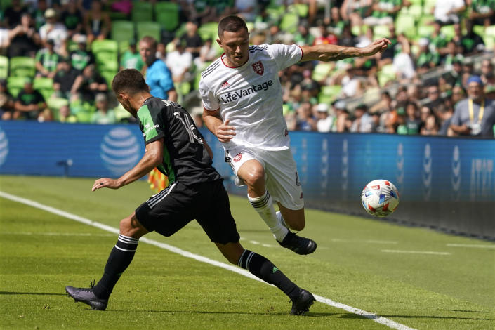 Real Salt Lake defender Donny Toia (4) drives past Austin FC midfielder Hector Jimenez (16) during the first half of an MLS soccer match in Austin, Texas, Saturday, Oct. 2, 2021. (AP Photo/Chuck Burton)