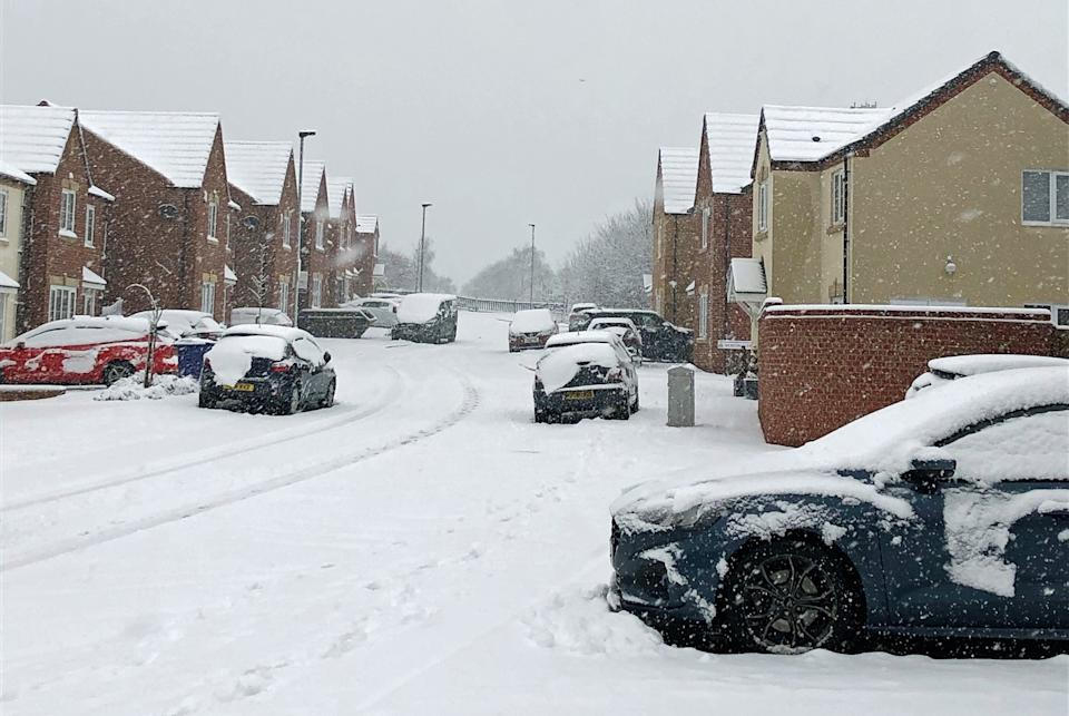 Snow covers a road in Monk Bretton, Barnsley, South Yorkshire,PA