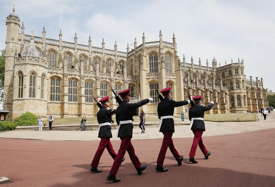 Soldiers from the King's Royal Hussars march past St. George's Chapel at Windsor Castle