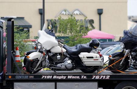 A motorcycle is seen on a wrecker before it is removed from the Twin Peaks restaurant, where nine members of a motorcycle gang were shot and killed, in Waco, May 19, 2015. REUTERS/Mike Stone