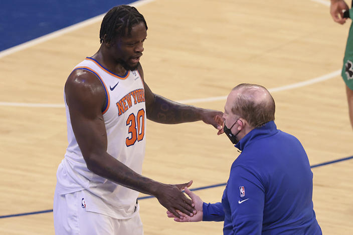 New York Knicks forward Julius Randle (30) celebrates with head coach Tom Thibodeau after an NBA basketball game against the Boston Celtics in New York, Sunday, May 16, 2021. (Vincent Carchietta/Pool Photo via AP)