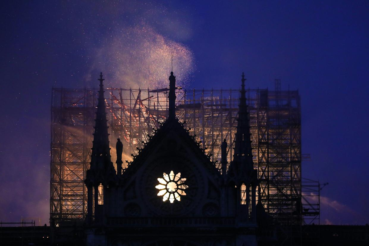 Smoke and flames rise during a fire at the landmark Notre-Dame Cathedral in central Paris on April 15, 2019, potentially involving renovation works being carried out at the site, the fire service said. (Photo: Ludovic Marin/AFP/Getty Images)