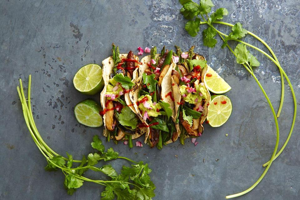 """<p>Taco Tuesday is no longer a threat to your waistline. Fresh veggies tossed with chipotle and slightly charred on the grill are smoky and satisfying.</p><p><a href=""""https://www.goodhousekeeping.com/food-recipes/a38332/grilled-asparagus-and-shiitake-tacos-recipe/"""" rel=""""nofollow noopener"""" target=""""_blank"""" data-ylk=""""slk:Get the recipe for Grilled Asparagus and Shiitake Tacos »"""" class=""""link rapid-noclick-resp""""><em><span class=""""redactor-invisible-space"""">Get the recipe for Grilled Asparagus and Shiitake Tacos »</span> </em></a><br></p>"""