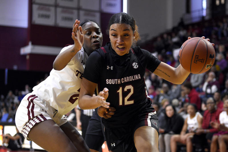 South Carolina's Breanna Beal, right, dribbles the ball past Temple's Asonah Alexander during the first half of an NCAA college basketball game, Saturday, Dec. 7, 2019, in Philadelphia. (AP Photo/Derik Hamilton)