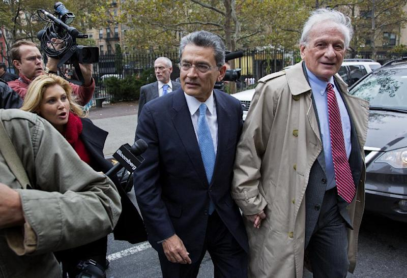 Former Goldman Sachs and Procter & Gamble Co. board member Rajat Gupta, center, arrives at court in New York Wednesday, Oct. 24, 2012. Gupta is to be sentenced after being found guilty insider trading by passing secrets between March 2007 and January 2009 to a billionaire hedge fund founder who used the information to make millions of dollars. At right is Gupta's attorney Gary Naftalis. (AP Photo/Craig Ruttle)