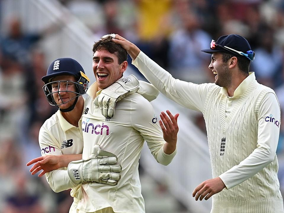 Dan Lawrence of England celebrates taking the wicket of Will Young of New Zealand (Getty)