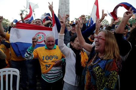People celebrate the rejection of a proposed amendment to allow presidential second terms, in front of the Paraguayan Congress, in Asuncion, Paraguay April 26, 2017. REUTERS/Jorge Adorno