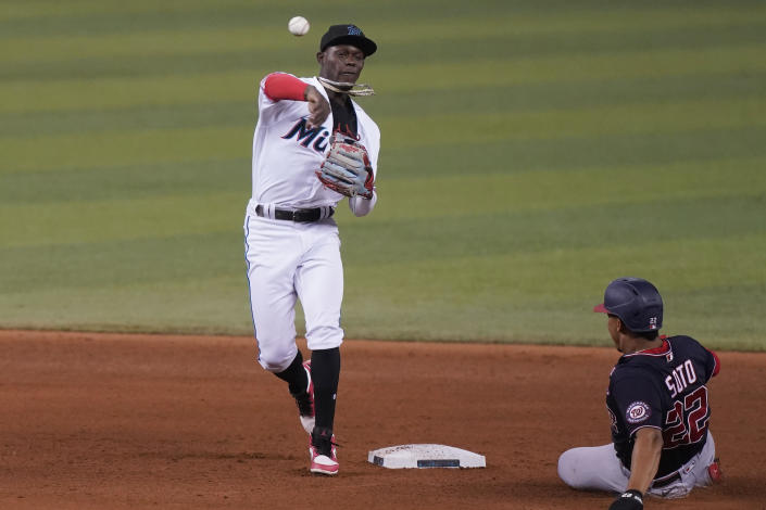Washington Nationals' Juan Soto (22) is out on second base as Miami Marlins second baseman Jazz Chisholm Jr. throws to first to complete the double play during the fifth inning of a baseball game, Wednesday, Sept. 22, 2021, in Miami. (AP Photo/Marta Lavandier)