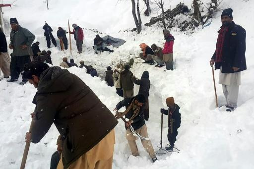 Local residents search for victims of an avalanche that hit the  Neelum Valley in Pakistan-administered Kashmir