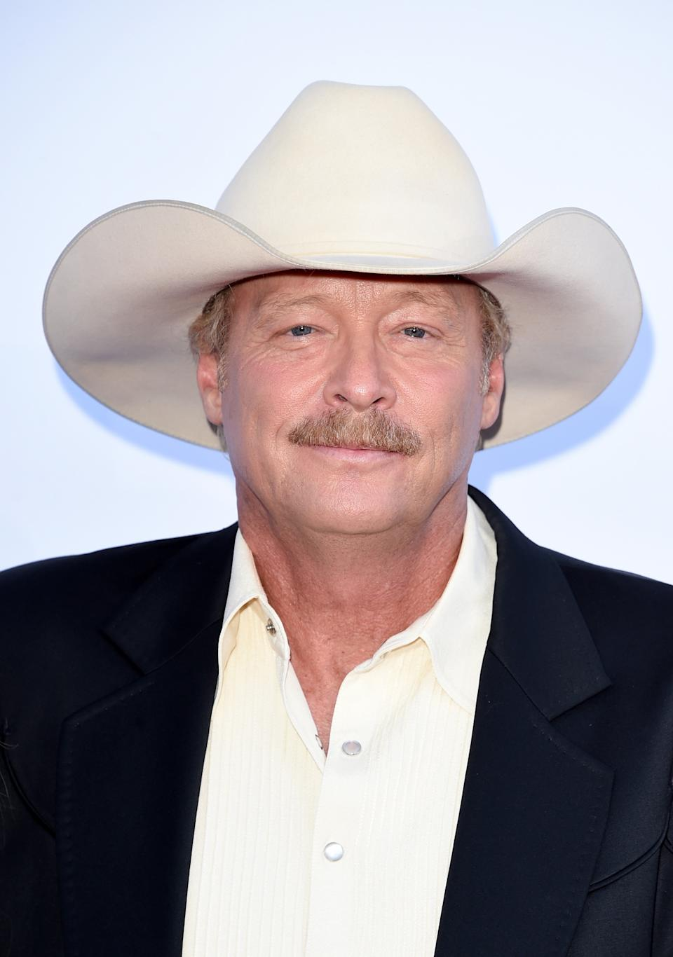 Alan Jackson says CMT, a degenerative condition that effects the muscles and nerves, has made performing difficult. (Image via Getty Images).