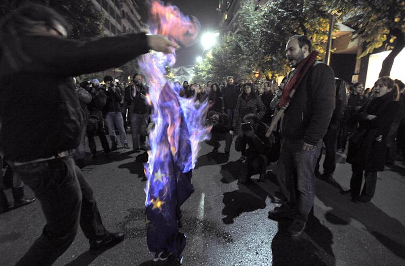 "FILE - Demonstrators burn an EU flag in this file photo dated Thursday Nov. 17, 2011, in Thessaloniki, Greece.  It is announced Friday Oct. 12, 2012, that the European Union has been awarded the Nobel Peace Prize for its efforts to promote peace and democracy in Europe, in the midst of the union's biggest crisis since its creation in the 1950s. The Norwegian prize committee said the EU receives the award for six decades of contributions ""to the advancement of peace and reconciliation, democracy and human rights in Europe. (AP Photo/ Nikolas Giakoumidis, File)"