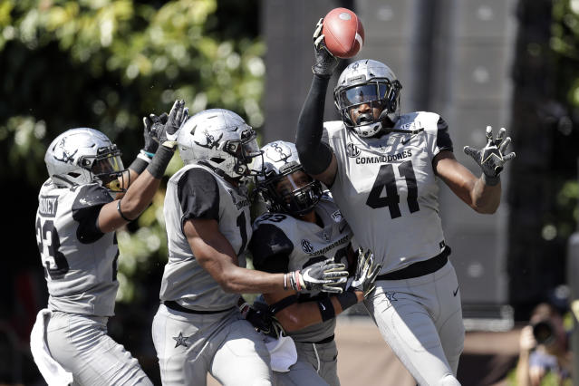 Vanderbilt linebacker Elijah McAllister (41) celebrates after recovering a fumble in the end zone for a touchdown against LSU in the first half of an NCAA college football game Saturday, Sept. 21, 2019, in Nashville, Tenn. (AP Photo/Mark Humphrey)