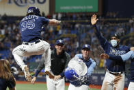 Tampa Bay Rays' Brett Phillips (35) celebrates with teammates after hitting a three-run home run against the Detroit Tigers during the 10th inning of a baseball game Friday, Sept. 17, 2021, in St. Petersburg, Fla. (AP Photo/Scott Audette)