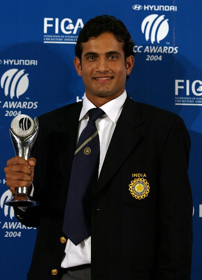 LONDON - SEPTEMBER 7:  Irfan Pathan celebrates winning the award for Emerging player of the year during the ICC Awards 2004 on September 7, 2004 at Alexandra Palace in London, England.  (Photo by Ian Walton/Getty Images)