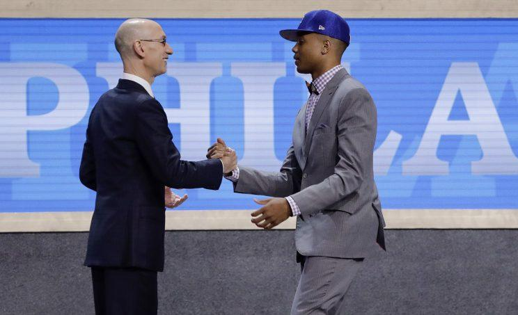 NBA commissioner Adam Silver congratulates Markelle Fultz on being drafted first. (AP)