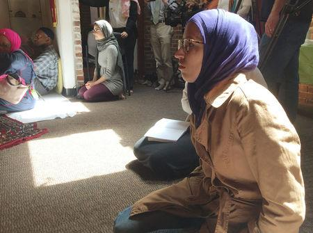 Worshipers sit and listen to prayers and a sermon at the Qal'bu Maryam Women's Mosque which held its first service on Good Friday in Berkeley