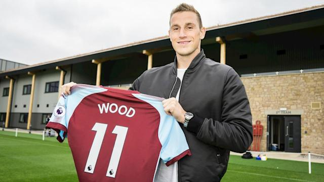 Chris Wood has completed his move from Leeds United to Burnley, revealing the Premier League was his motivation.