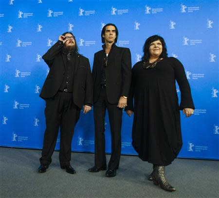 "Directors Ian Forsyth (L) and Jane Pollard (R) pose with cast member Nick Cave during a photocall promoting the movie ""20,000 Days on Earth"" at the 64th Berlinale International Film Festival in Berlin February 10, 2014. REUTERS/Thomas Peter"