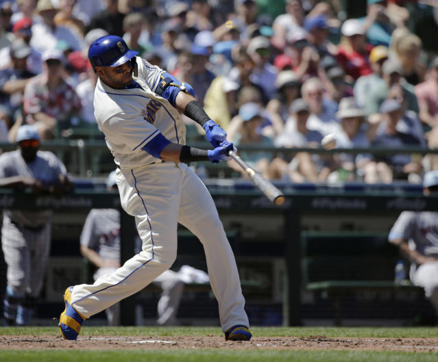 Seattle Mariners' Nelson Cruz hits a solo home run on a pitch from Boston Red Sox starting pitcher Eduardo Rodriguez during the fourth inning of a baseball game, Sunday, June 17, 2018, in Seattle. (AP Photo/John Froschauer)
