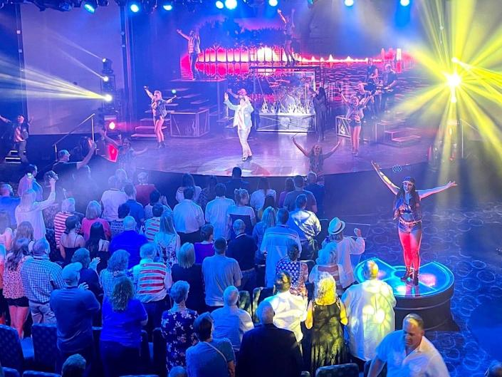 Dancers perform to a crowd onboard the Carnival Vista cruise ship.