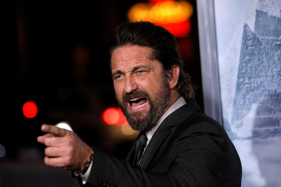 """Cast member Gerard Butler poses at the premiere for """"Geostorm"""" in Los Angeles, California, U.S. October 16, 2017. REUTERS/Mario Anzuoni"""